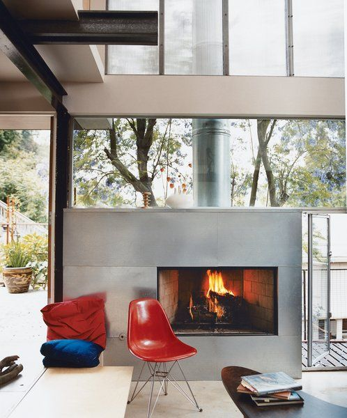 a fireplace clad with galvanized steel for a modern space looks lightwieght and chic