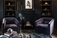 12 a luxurious dark living room with black walls, purple chairs, a grey faux fur rug and some brass touches for a chic look