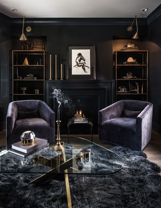 a luxurious dark living room with black walls, purple chairs, a grey faux  fur