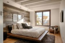 12 a modern bedroom with a reclaimed wooden wall and a wood floating platform bed