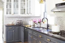 12 a vintage-styled kitchen with white and grey cabinets, brass touches and a black countertop