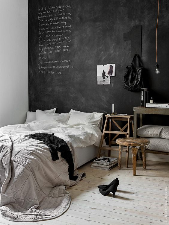 a Scandinavian space with a chalkboard headboard wall for a creative dialogue between the members of the family and some art
