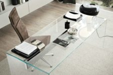 13 a clear glass desk looks very chic and eye-catchy, and though it doesn't have storage drawers, it's very stylish