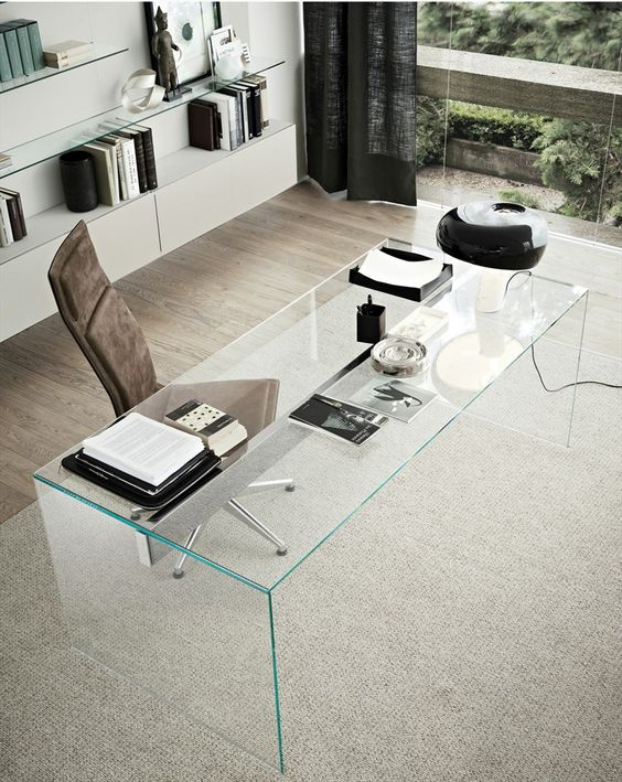 a clear glass desk looks very chic and eye-catchy, and though it doesn't have storage drawers, it's very stylish
