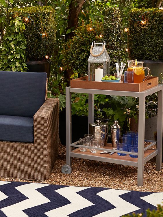 a bar cart can be placed in your patio or garden to use it as an outdoor bar
