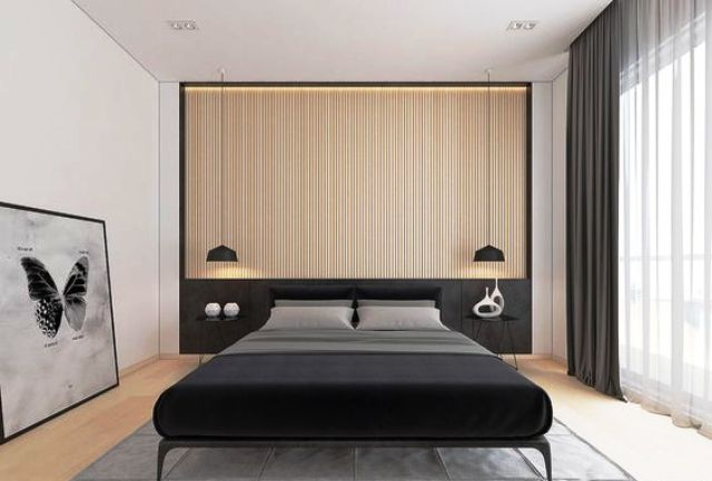 a light colored wood slat headboard wall and a black bed, black pendant lamps and curtains