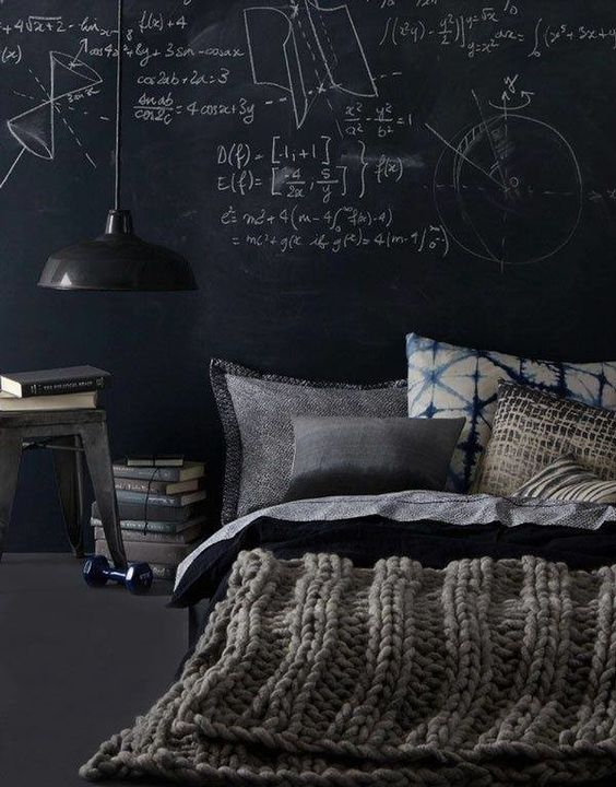 a manly space with a platform bed, a vintage lamp and a chalkboard wall for creativity and thoughts