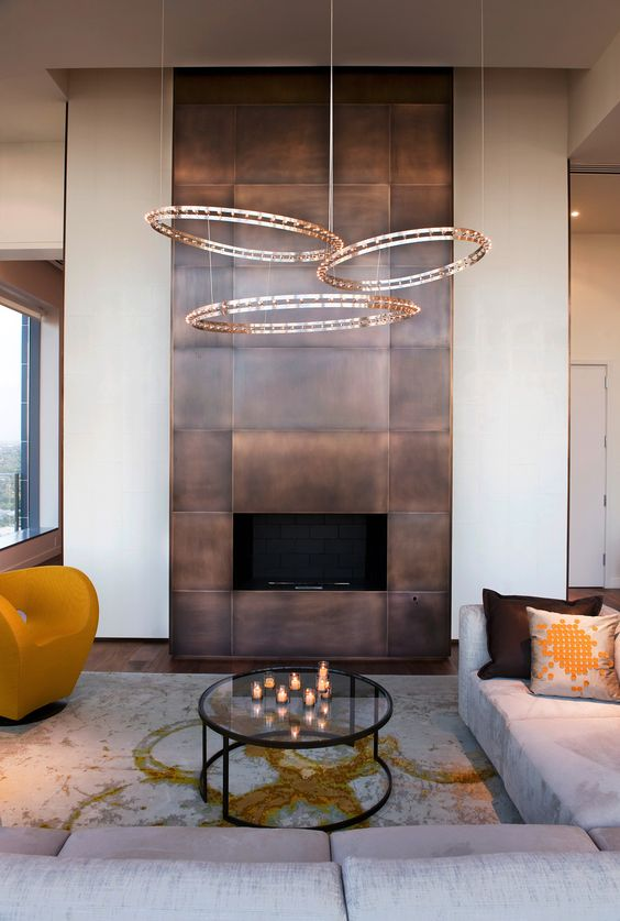 a modern fireplace clad with darkened copper looks really wow and impressive