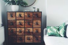 14 an industrial wooden apothecary cabinet with black metal handles makes an accent in this neutral space