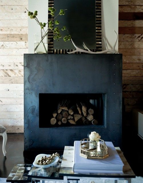 a fireplace clad with metal sheets is a great feature for industrial and masculine spaces