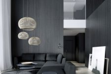 15 a minimalist space with black wooden walls and furniture, cool pendant lamps highlight the double height ceiling
