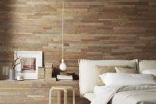 15 a modern bedroom is made cozier and more welcoming with a reclaimed wooden wall, whitewashed floor and wooden furniture