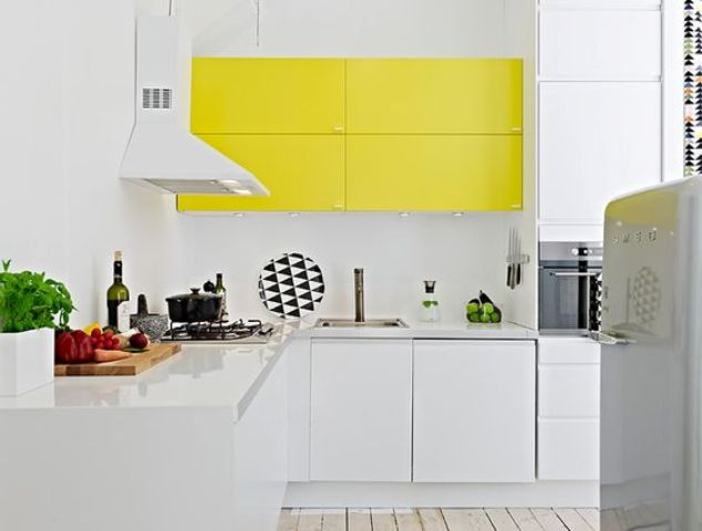 a white kitchen with a suspended lemon yellow cabinet to add a colorful touch and to make the kitchen vivacious