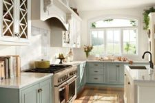 15 pastel blue and white ktichen in vintage farmhouse style, with a white kitchen island