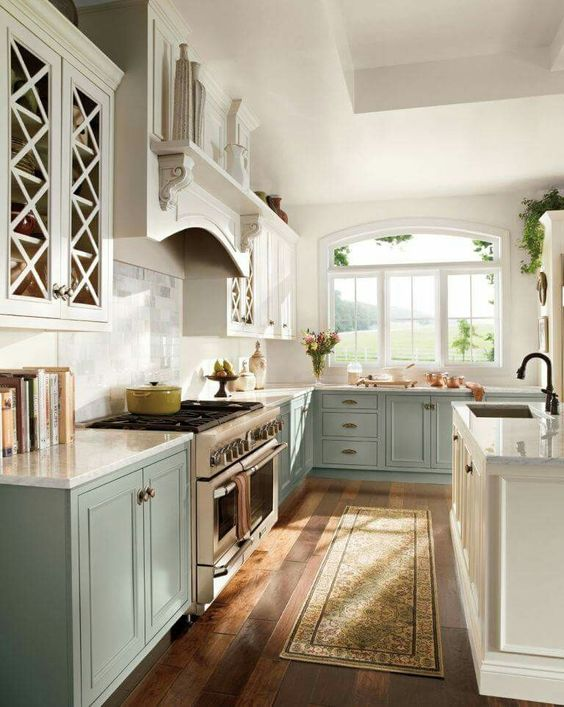 pastel blue and white ktichen in vintage farmhouse style, with a white kitchen island