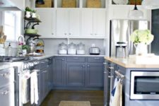 16 a framhouse-styled kitchen with grey and white cabinets, wicker touches and vintage lamps