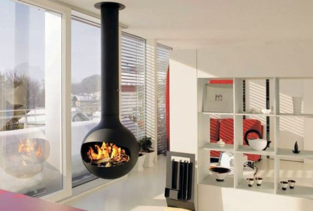 a modern space is spruced up with a hanging fireplace looks gorgeous