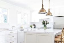 17 a farmhouse kitchen with brass vintage touches and marble countertops for an eye-catchy touch