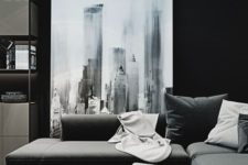 17 a modern moody space with a corner sofa, a small elegant coffee table, a large graphic artwork and matching textiles