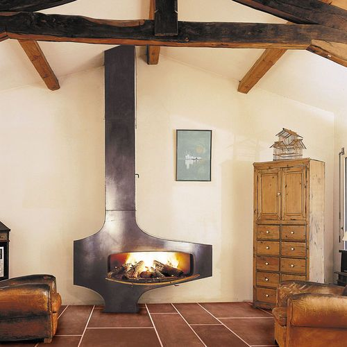 a vintage rustic space with a gorgeous wood burning fireplace with metal covers