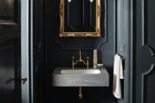 17 black panels covering the walls create an elegant and chic vintage space, wood clad floors for a refined feel