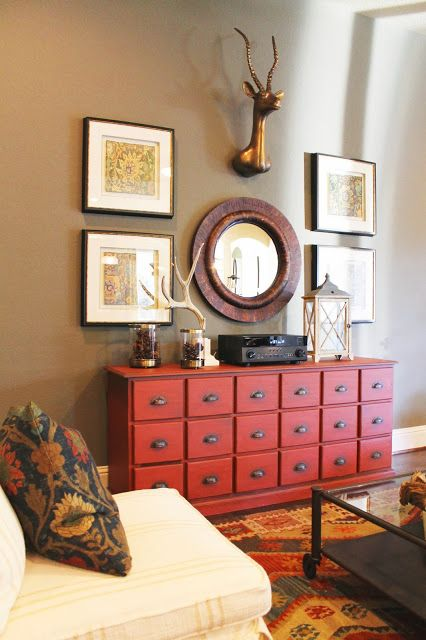to make the cabinet stand out, you can paint it in some bold shade, for example, red like here
