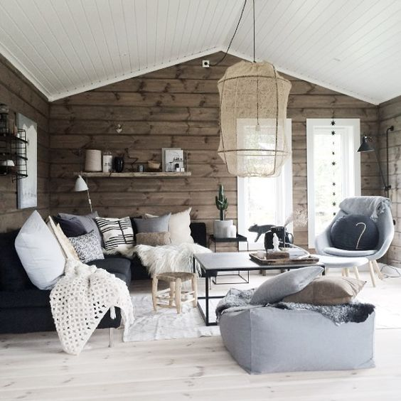 a Scandinavian space is made warmer and cozier with wooden walls in a natural finish