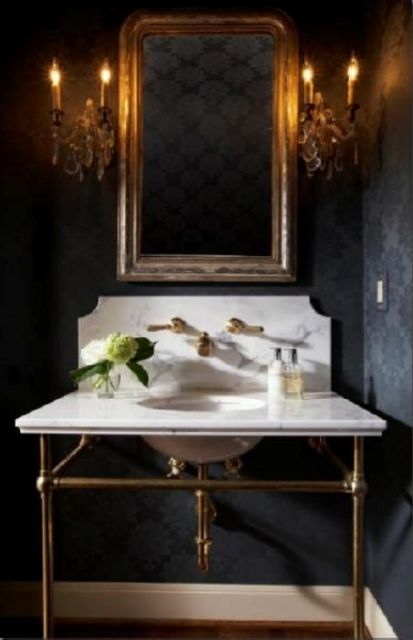 a marble and brass bathroom vanity perfectly fits the 1920s style and looks very refined