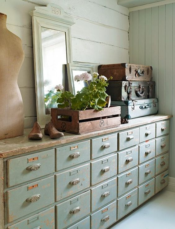 a shabby chic mint colored apothecary cabinet for a soft pastel interior