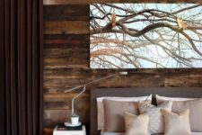 18 a stylish modern bedroom in shades of brown is added interest with a reclaimed wood wall