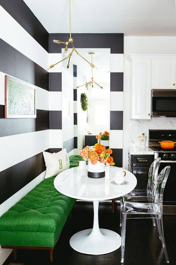 a bold green upholstered surface to add color to a monochromatic space
