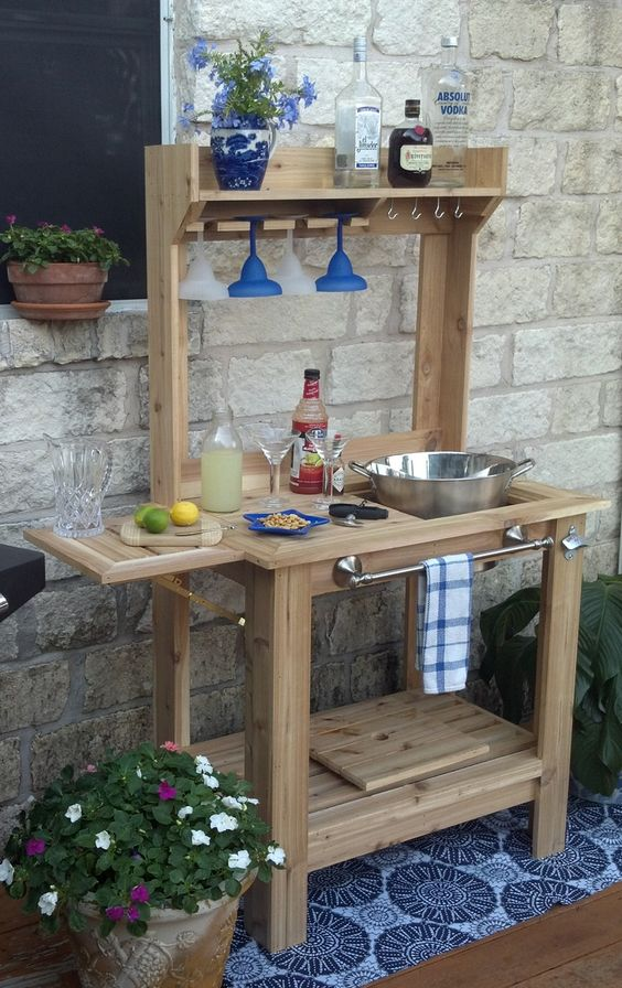 a custom-made wooden bar stand for a rustic patio provides comfort in using