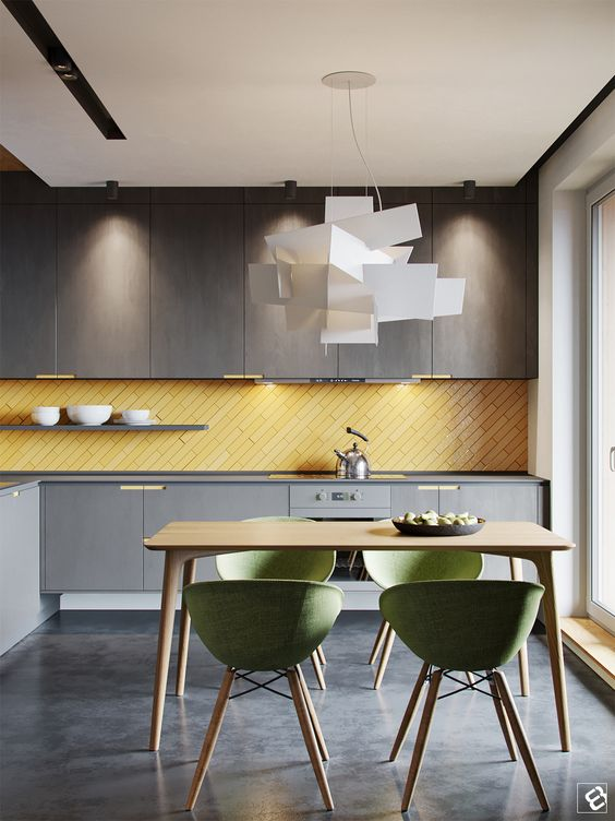 a minimalist moody grey kitchen with a sunny yellow tile backsplash clad in a diagonal way