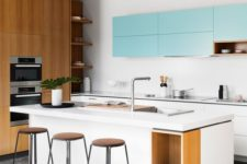 19 a white and light blue kitchen looks modern and refreshing, and natural wood touches make it cozier