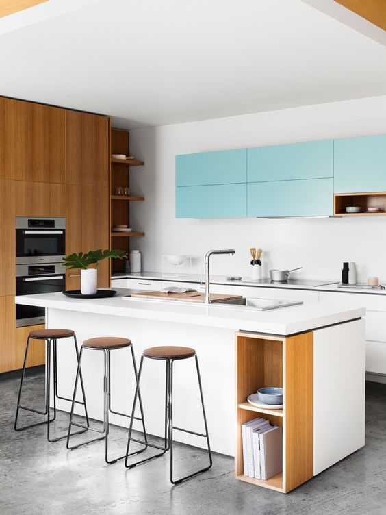 a white and light blue kitchen looks modern and refreshing, and natural wood touches make it cozier