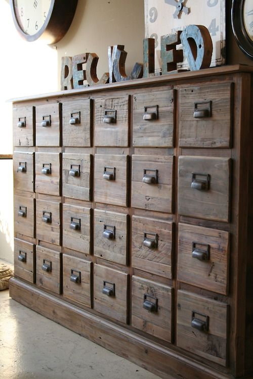 a wooden apothecary cabinet is great for a vintage or rustic space