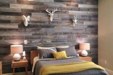 19 add a rustic touch to your space with a reclaimed wooden wall and faux animal heads