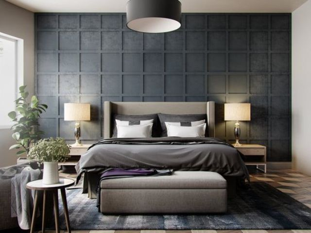 a black panel headboard wall stands out, and a grey upholstered bed with a matching pouf make it cozier
