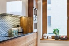 20 a cozy modern space with ivory and natural wood cabinets and a monochromatic geometric backsplash