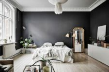 20 a dramatic Scandinavian space with black walls looks airy thanks to lots of light and light-colored wooden floors
