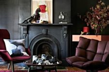 20 a moody space with black walls, a fuchsia rug and furniture and artworks