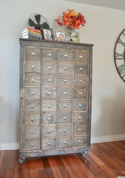 a reclaimed wood apothecary cabinet on casters will be a comfy storage unit for any space