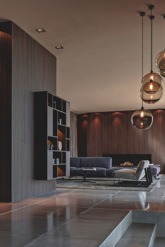 a stylish modern living room with a stained wooden wall with a fireplace that brigns texture in