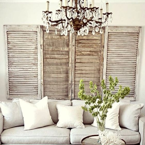 attach some shutters to the wall in the living room, they can be a nice decoration for a rustic feel