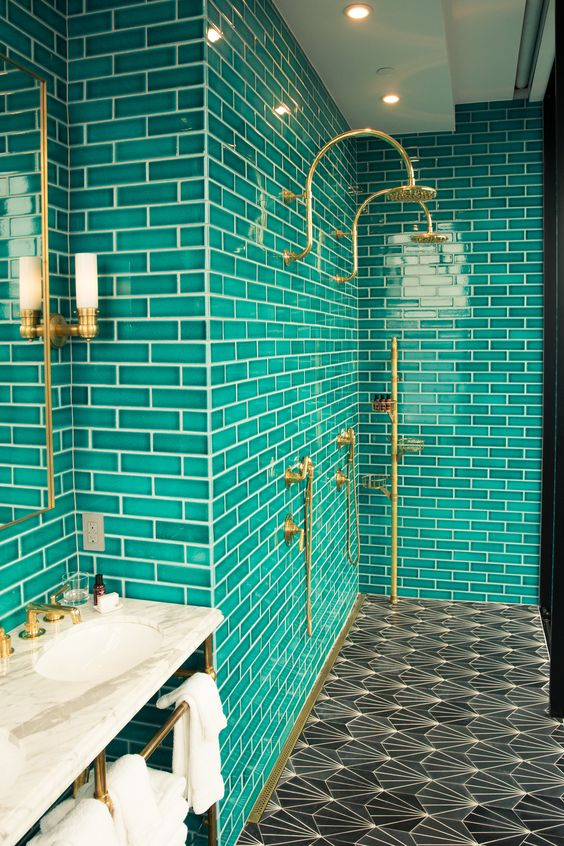 brass fixtures and mosaic tiles on the floor make the space more chic and more eye-catching