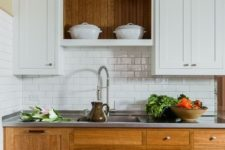 21 a cozy rustic kitchen with white and wooden cabinets of traditional design and a subway tile backsplash