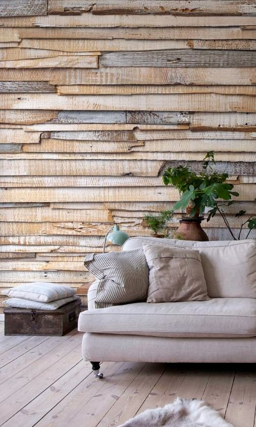 a weathered raw edge wood plank accent wall defines the whole space making a bold statement