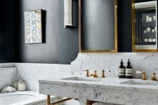 21 black walls and white marble for a bold modern space, and brass touches to make it more glam