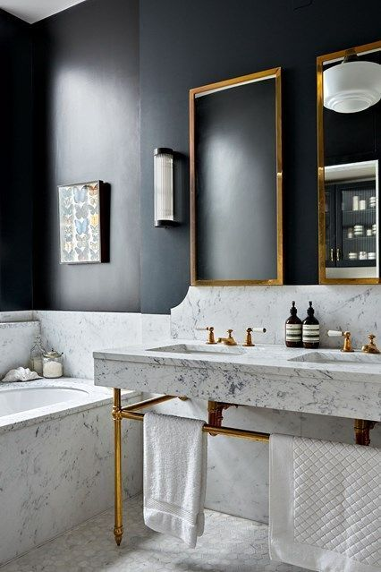 black walls and white marble for a bold modern space, and brass touches to make it more glam