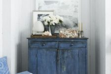 22 a colorful shabby chic cabinet is another great idea for storage in an awkward corner
